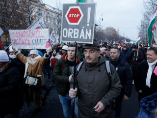 Around 10,000 in Hungary protest Orban's rule, calling new labor code a 'slave law'