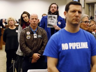 Protesters turn their back as disputed Virginia gas project vote delayed again