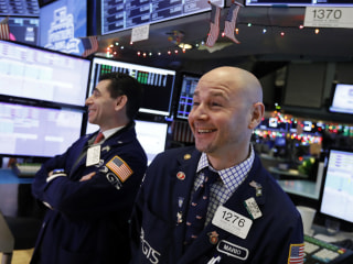 Wall Street surges after tentative shutdown deal, but trade fears linger