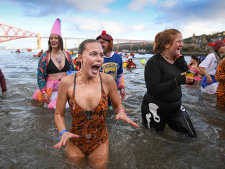 Photos: 'Polar Bear' swimmers dive into frosty waters to celebrate New Year's