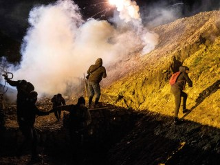 U.S. fires tear gas across Mexico border to stop migrants