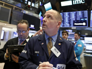 Dow closes down 660 points after Apple's shock warning sends tremors through markets