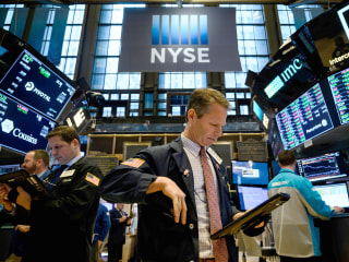 Wall Street nears record high on upbeat earnings, GDP data