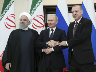 U.S. ally Turkey looks to Russia and Iran to protect its interests