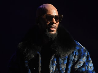 R. Kelly, charged with sexually abusing underage victims, has turned himself in