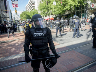 Friendly texts between Portland police and right-wing leader sow division in city