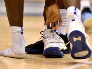 College star's exploding shoe comes as NBA appears poised to let players go pro at 18