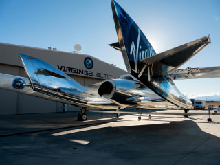 Virgin Galactic space plane takes first test passenger into space