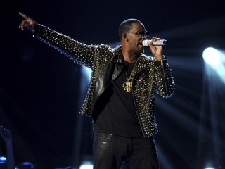 R. Kelly sexual abuse charges are celebrated by some: 'There is a god. She's Black'