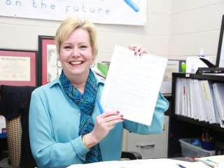 Teacher wins $10,000 in contest buried in insurance policy's small print