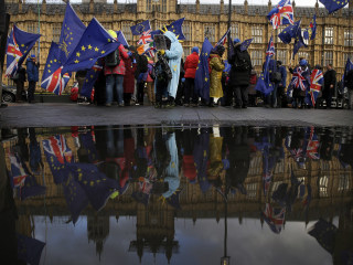After crushing PM May's Brexit plan, British lawmakers plot next steps