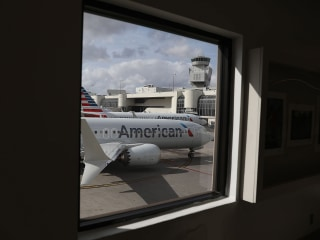 16 sick passengers on American Airlines flight transported from Logan Airport