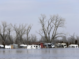 Historic flooding kills three, forces hundreds from homes across the Midwest