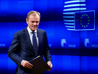 E.U. head Donald Tusk sees short Brexit delay if U.K. backs divorce deal