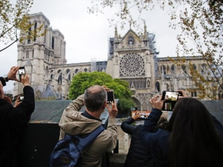 French President Macron vows to rebuild Notre Dame Cathedral within five years