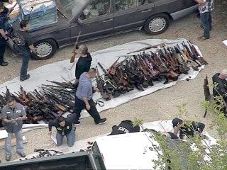 Man arrested after 1,000 guns found at Los Angeles home is charged