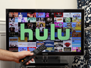 Comcast agrees to sell its stake in Hulu to Disney