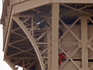 Man climbs Eiffel Tower and hangs on for more than seven hours