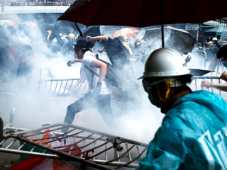 Hong Kong protesters flee tear gas after extradition bill debate is delayed