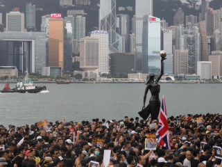 Hong Kong protesters march again, aiming to take their message to mainland Chinese