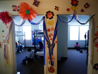 Reporters get a tour of a new facility for migrant minors in Texas