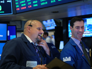 Dow notches record high, closing above 27,000 for first time