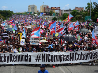 Puerto Ricans flood streets, demand resignation of governor in huge protest