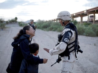 Guatemalan mother begs soldier to let her and 6-year-old son enter U.S.
