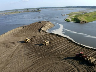 Flooded out, farmers find work rebuilding the levees that failed them