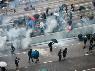 Hong Kong police fire tear gas, water cannon as latest protests turn violent