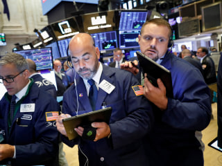 Dow rises 100 points, inches closer to record high amid China trade optimism