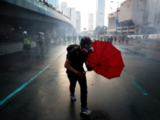 Hong Kong police fire tear gas, water cannon as violence flares after protesters defy ban