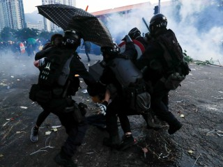 Hong Kong police defend shooting protester as 'lawful and reasonable'