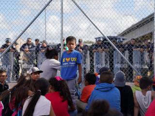 Migrant protesters occupy U.S.-Mexico border bridge, close crossing