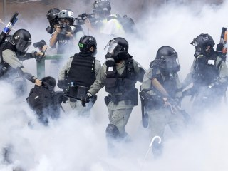 Hong Kong police lay siege to university where hundreds of protesters trapped