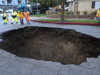 Her car plunged into a giant sinkhole. Los Angeles is paying her $4 million.