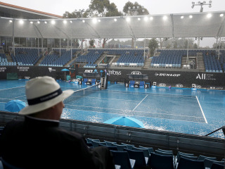 First smoke, now rain as Australian Open struggles with weather