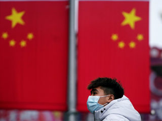 China imposes travel restrictions on 33 million people as virus toll climbs