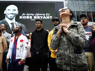 Thousands of stunned Kobe Bryant fans gather in Los Angeles to mourn his death