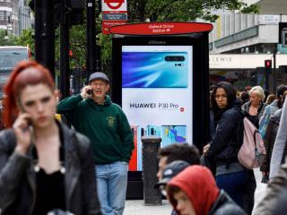 U.K. chooses China's Huawei to build parts of its 5G network despite U.S. warnings