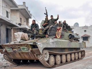 Syrian troops capture key town in rebel-held Idlib province