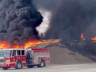 Indiana overpass engulfed in flames after tanker truck overturns