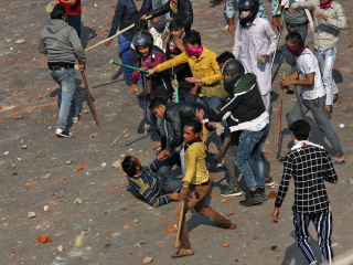 Deadly violence sweeps Indian capital of New Delhi during Trump visit