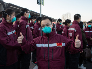 China reports no new coronavirus cases, offers medical aid overseas