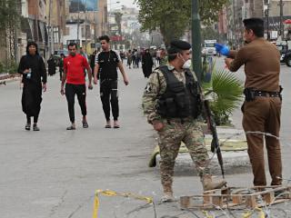 Hundreds of thousands defy Iraq's coronavirus curfew to visit martyred imam's shrine