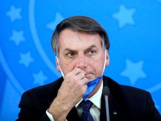 Facebook, Twitter bar video of Brazilian president endorsing unproven antiviral drug