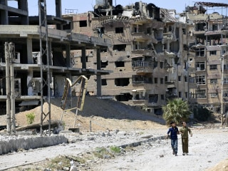 Assad's air force attacked Syrian civilians with sarin, chlorine, says watchdog