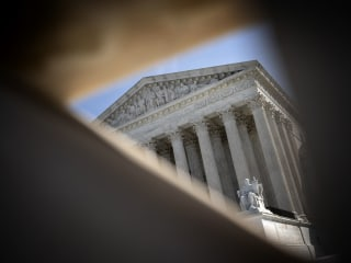 In historic first, Supreme Court to hear arguments by phone