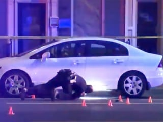 Baltimore police searching for suspect who shot officer, carjacked another driver