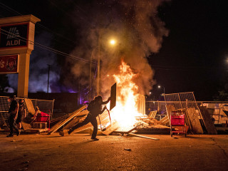Peaceful Minneapolis protests over George Floyd's death turn violent